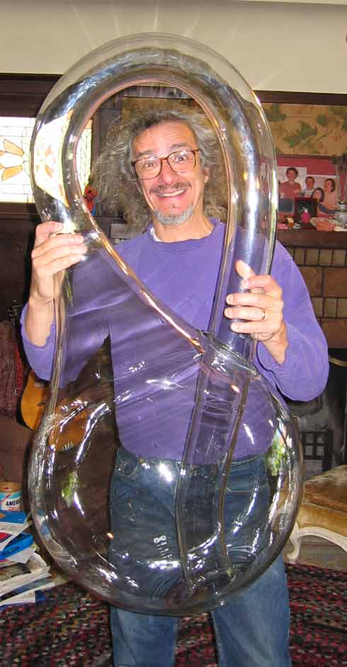 Cliff Stoll with giant Klein Bottle