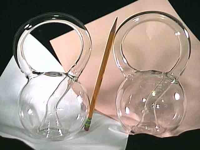 Two Question Mark Klein Bottles, one with calibrations
