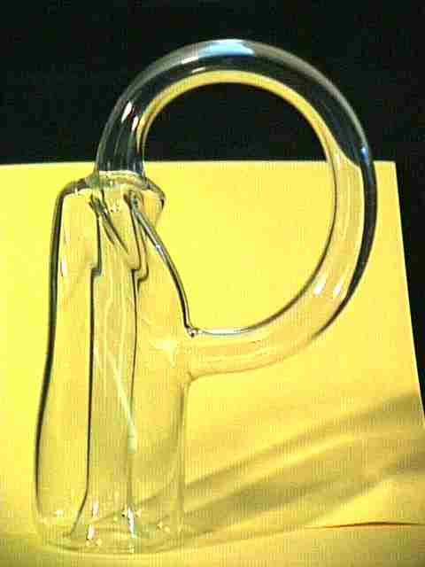 Here's a Klein Bottle with a twisted bottom and a wide side loop.